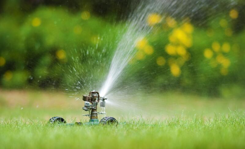 water sprinkler system working in lawn